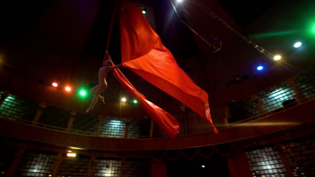 woman dancer on aerial silk, aerial contortion, Slow motion