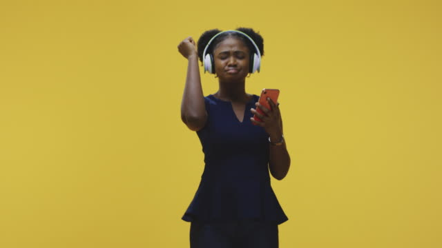 Woman dancing and listening music video