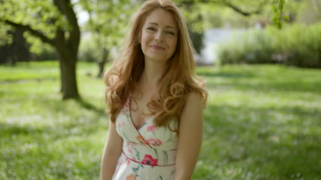Woman dancing in the woods Woman dancing in the springtime woods, handheld real life stock videos & royalty-free footage