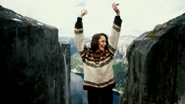 Woman dancing on the background of  scenic view of Lysefjorden from Kjerag mountain video