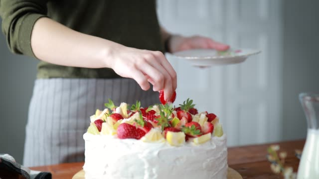Woman Decorating Cake With Fruits Woman Giving Final Touch To Delicious Cake, Decorating It With Fruits ingredient stock videos & royalty-free footage