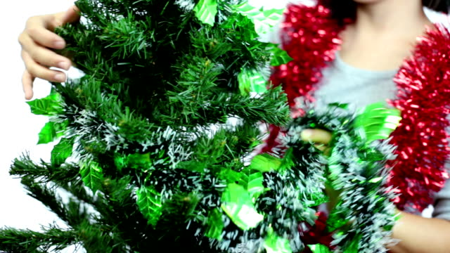 Woman decorating Christmas tree video