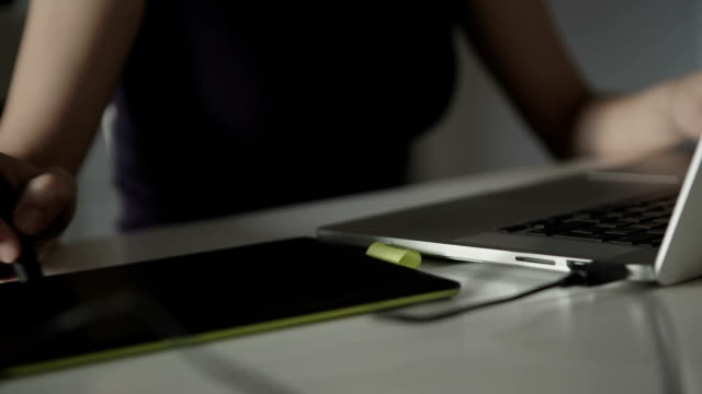 woman designer draws on a graphics tablet video