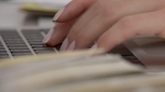 Woman designer typing on laptop video