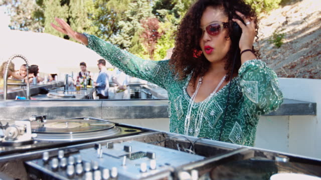 Woman DJing at Pool Party video