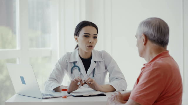 Woman doctor and senior in a hospital video