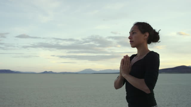 4K UHD: Woman Doing a Prayer Pose while Practicing Yoga in the Desert video