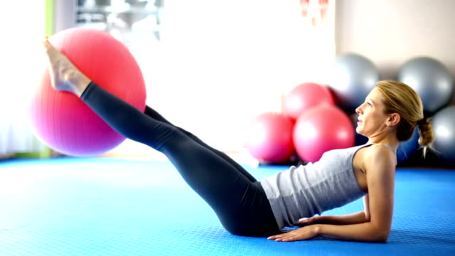 Woman doing abs. Closeup of adult blond woman doing abs with Pilates ball leaning stock videos & royalty-free footage