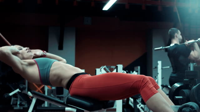 Woman doing crunch exercises for abdominal muscles video