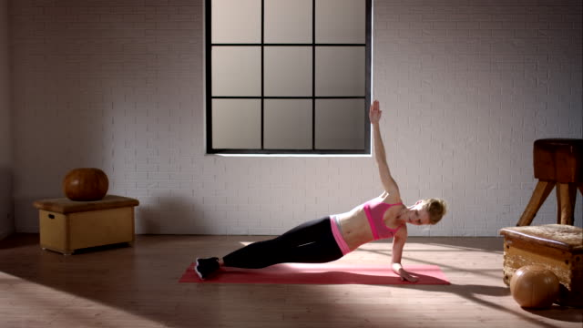 Woman doing her workout in gym (pelvis lift laterally)