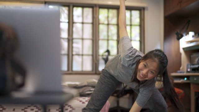 Woman Doing Hiit Exercise High-intensity interval training during Online Training Session at home in covid-19 corona virus situation