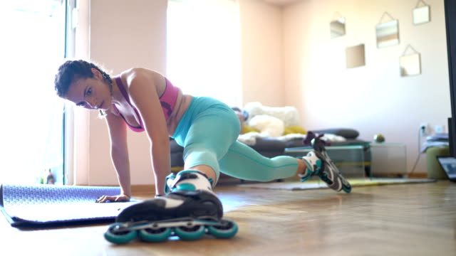Woman doing home workout in living room video