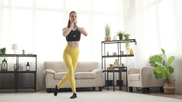Woman doing lunges at home video
