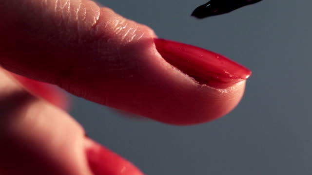 Woman doing manicure cosmetic macro close up video
