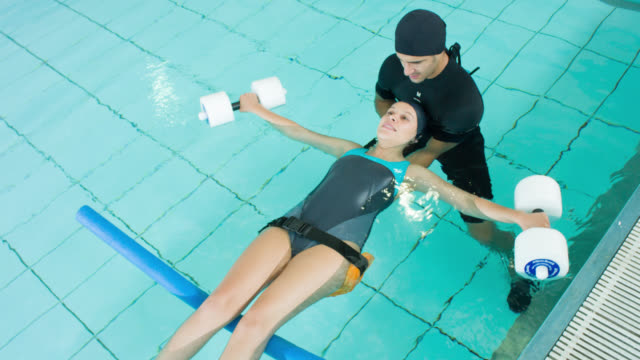 woman doing physical therapy in the water - fisioterapia video stock e b–roll