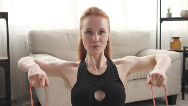 Woman doing seated row exercise with resistance band video