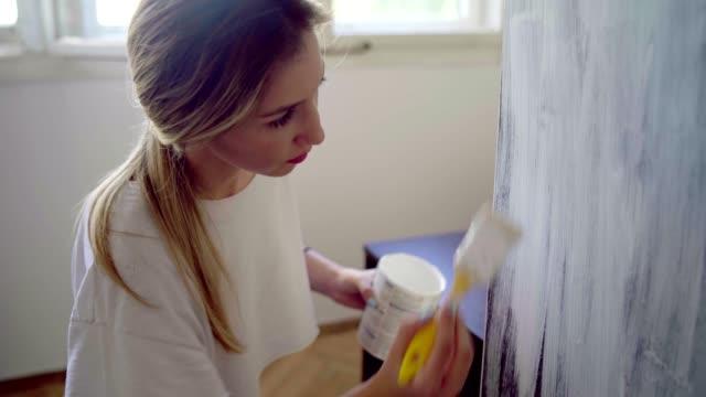 woman doing some home improvements - decorare video stock e b–roll