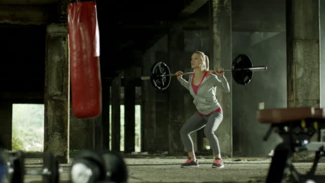 Woman doing squats video