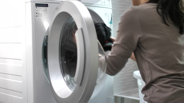 Woman doing the laundry with Washing Machine at home Woman doing the laundry with Washing Machine at home chores stock videos & royalty-free footage