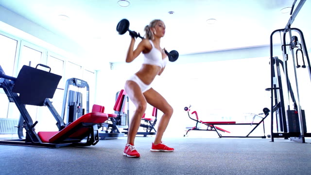 woman doing workout with barbell - sports medicine stock videos and b-roll footage