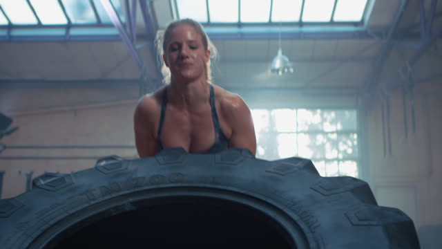 Woman doing workout with big tire video