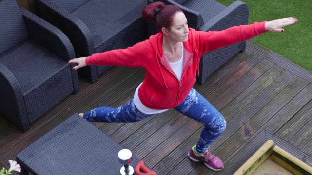 A Woman Doing Yoga and Exercise in Back Yard video