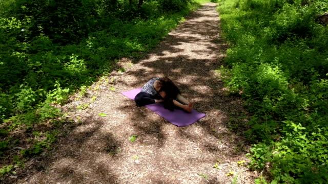 woman doing yoga stretching - penombra video stock e b–roll
