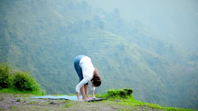 Woman doing yoga Sun Salutation Surya Namaskar video