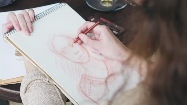 Woman drawing human sketch video