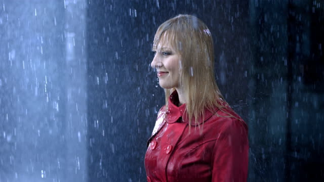 Woman Drenched To The Skin HD1080p: Slow Motion shot of a mid-adult businesswoman drenched to the skin while standing in the rain. drenched stock videos & royalty-free footage