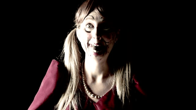 Woman Dressed As Creepy Doll Laughing video