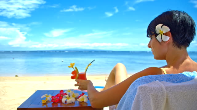 WS DS Woman Drinking Cocktail On The Beach video