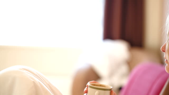 Woman drinking coffee in the morning video