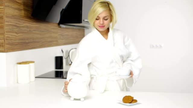 stockvideo's en b-roll-footage met woman drinking coffee smile, drink tea breakfast - camelia white