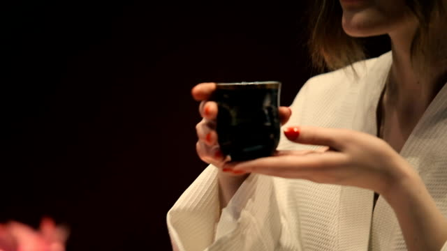 Woman drinking tea and smiling. video