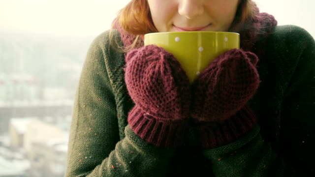 Woman Drinks Hot Tea or Coffee From yellow Cup on Winter Morning Woman Drinks Hot Tea or Coffee From Cup at Cozy Snowy House Garden on Winter Morning chalet stock videos & royalty-free footage