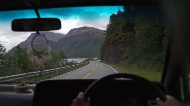 woman driving a camper van woman driving a camper van. Vanlife in Norway hippie stock videos & royalty-free footage