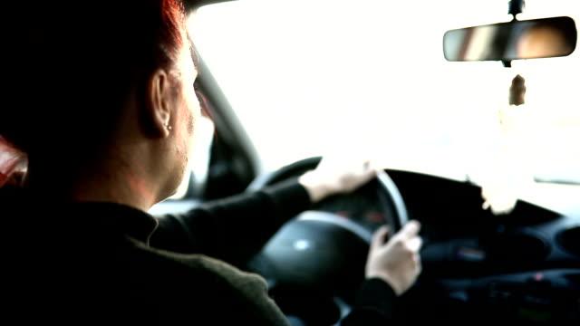 Woman driving a car video