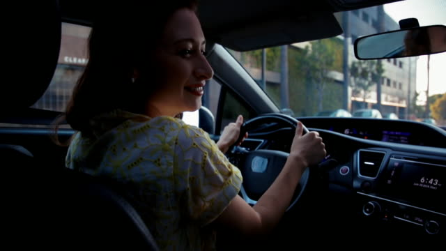 woman driving and smiling - driver stock videos and b-roll footage