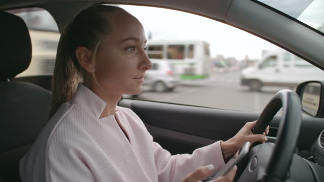 Woman Driving and Texting video