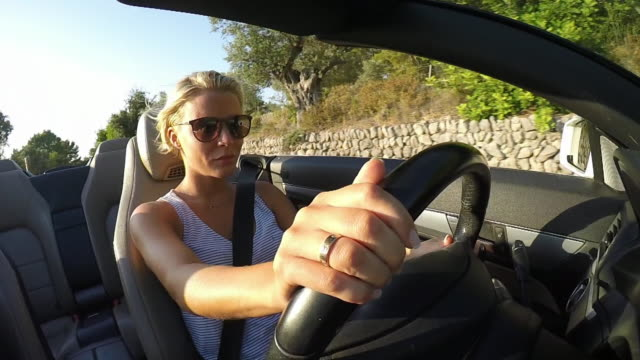 Woman driving convertible car. In vehicle close-up. Slow motion luxury car stock videos & royalty-free footage