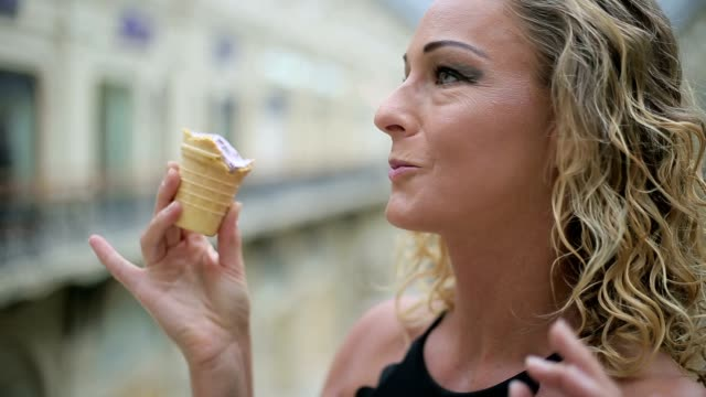 woman eat ice cream - tasty movie filmów i materiałów b-roll