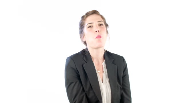 Woman eating a red apple on a white studio background video