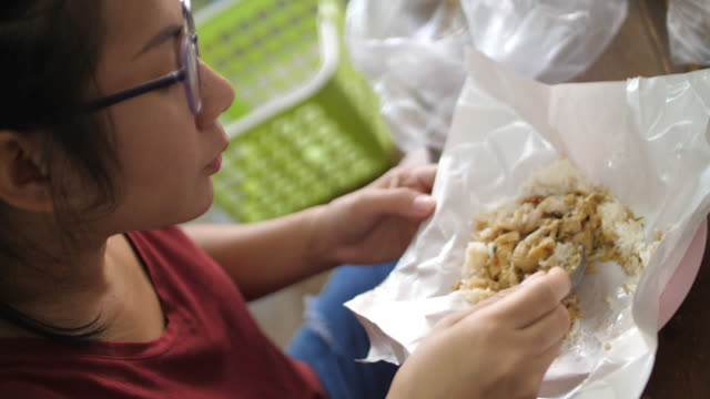 Woman eating chicken rice