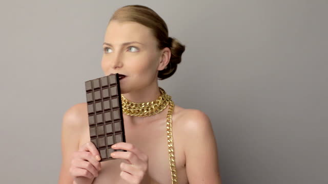 woman eating chocolate video