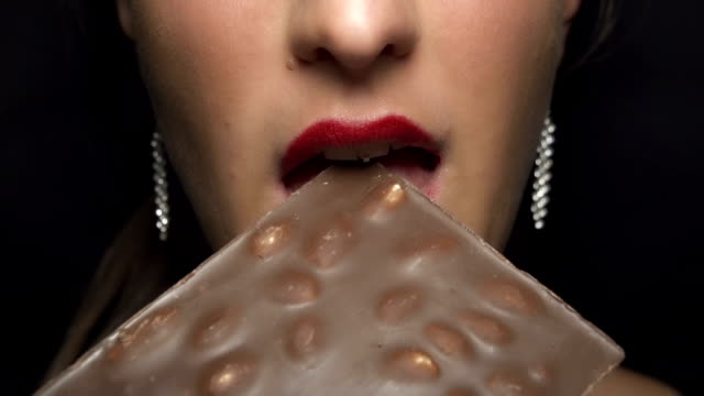 SLOW MOTION: Woman eating chocolate video