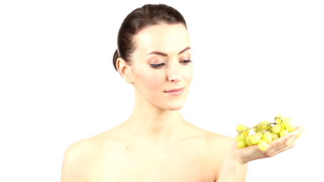 Woman eating grapes Attractive young woman eating fresh grapes from the vine smiling pinching stock videos & royalty-free footage