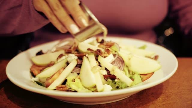 woman eating healthy salad 4k