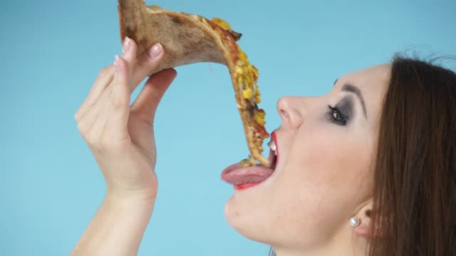 Woman eating hot fresh pizza, closeup