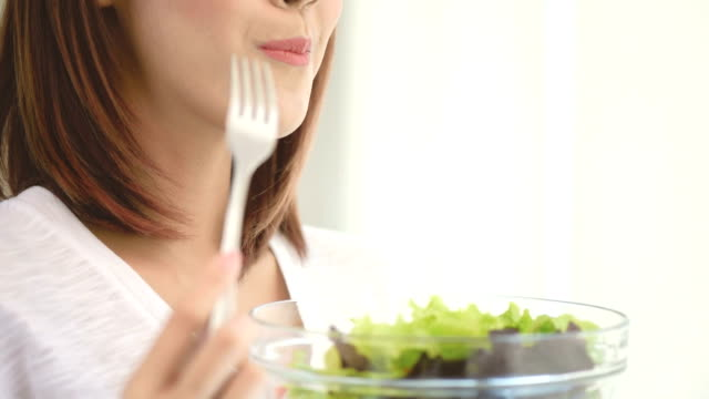 Woman eating salad video